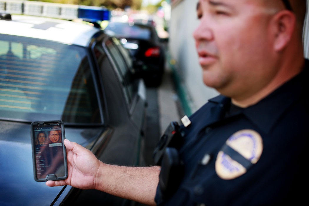 A California policeman displays a mobile face recognition app. (Photo: Sandy Huffaker/The New York Times/Redux)